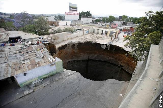 k-hole-was-large-enough-to-swallow-up-about-a-dozen-homes-which-fell-330-feet-down-into-the-hole.jpg
